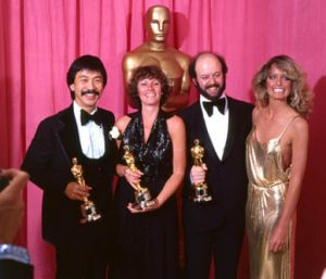 From left: Richard Chew, Marcia Lucas, Paul Hirsch, and Farrah Fawcett at the 1977 (50th) Academy Awards ceremony.